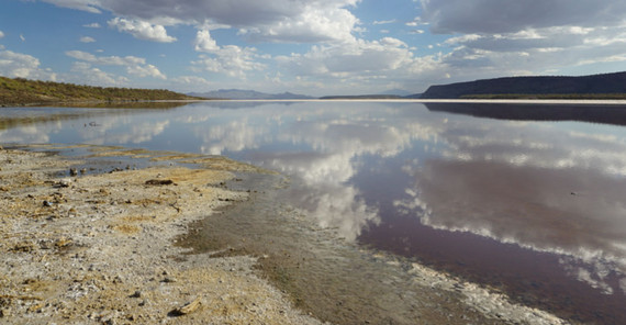 Clouds reflecting in lake Magadi, Kenya, located in the Eastern Branch of the East African Rift System. The high rising flanks of the Rift's border faults can be seen in the background. | Photo: Corinna Kalich, University of Potsdam