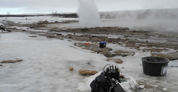 Eruption of Strokkur as seen from the west on 12 March 2020. It was recorded by the blueSeis-3A rotational sensor (black) and Trillium Compact seismometer (green) in the foreground. The pathway is open for tourist in summer but was icy and closed in winter. | Photo: Eva Eibl