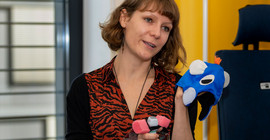 Dr. Aude Noiray explains a mobile ultrasound device for testing babies. | Photo: Tobias Hopfgarten