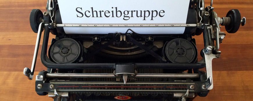 "Typed sheet from a typewriter that is almost one hundred years old. The sheet of paper reads ""Writing Group"" in oversize letters. Photo: Ariane Wittkowski"