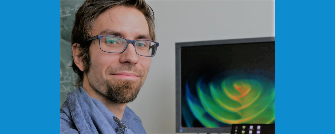 portrait of Prof. Dietrich in front of his computer simulation