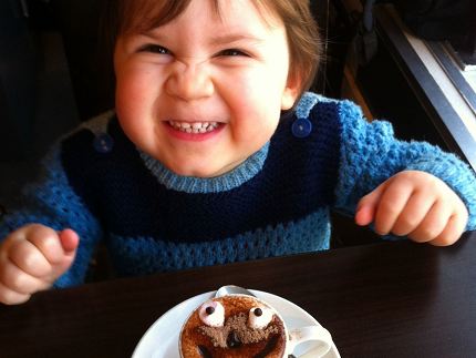 small child in front of a muffin
