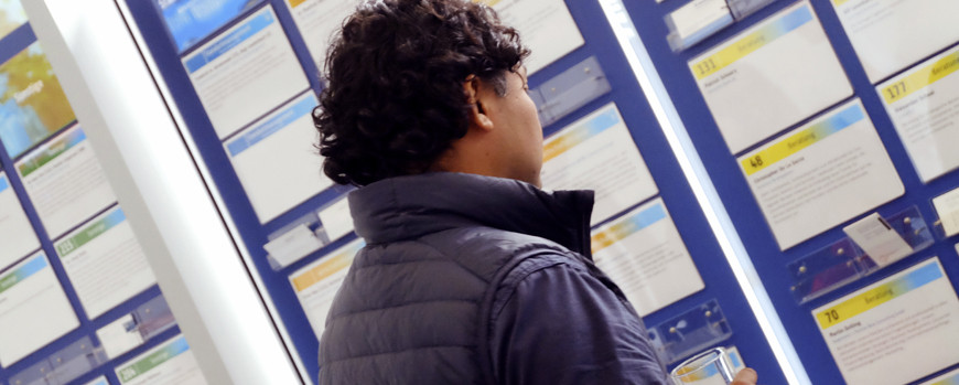 Man looking at information wall