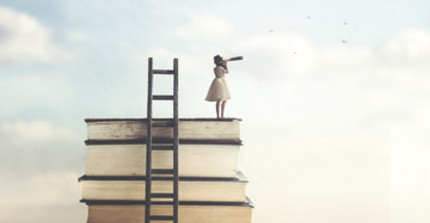 Woman with a telescope is standing on pile of books