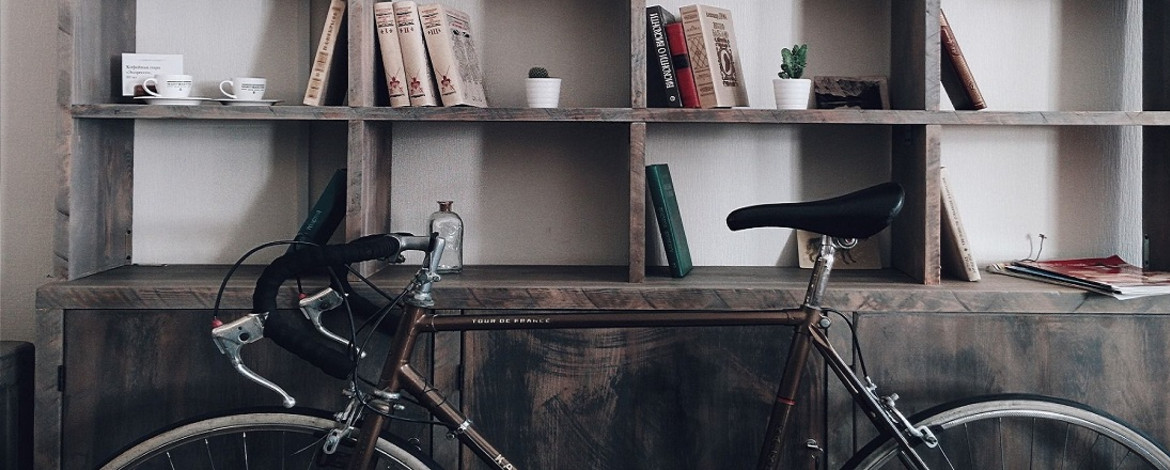road bike in front of a bookshelf