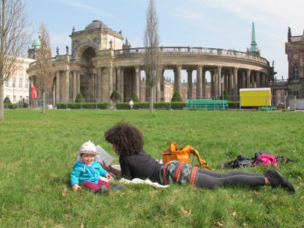 "student with small child at university campus ""Am Neuen Palais"""