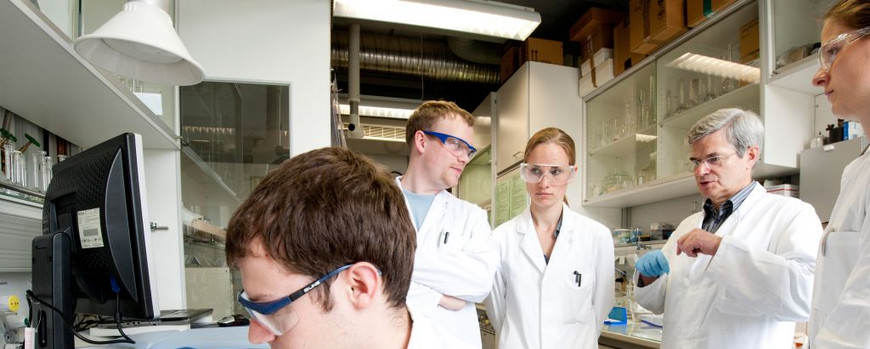 Dr Mickler with students in a lab